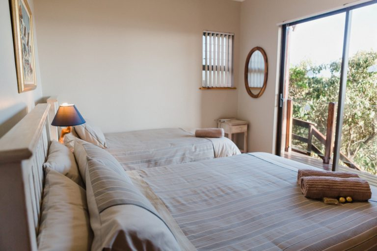 Second bedroom, beach house apartment. Double bed, single bed